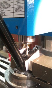 Milling a new port in the Barrel support.